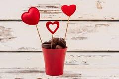 Pot de fleur avec des chocolats Photographie stock