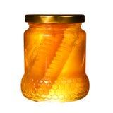Pot de miel avec le nid d'abeilles d'isolement sur le blanc Image stock