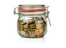 Pot de mise en boîte avec des pièces de monnaie Images stock