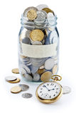 Pot de pièce de monnaie de cotisations de retraite de temps Photo stock