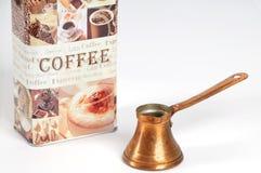 POT del caffè con la scatola metallica Immagine Stock