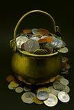 POT delle monete Immagini Stock