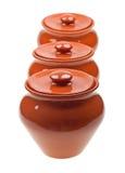 POT di ceramica per la cottura isolata su bianco Fotografia Stock