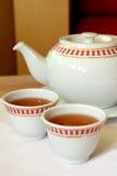 POT e tazze del tè Fotografie Stock