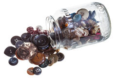 Pot en verre avec des boutons de vêtements Photographie stock