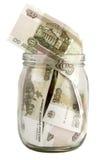 Pot en verre avec des factures d'un cent-rouble Photographie stock libre de droits