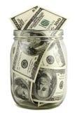 Pot en verre avec des notes de cent-dollar Image libre de droits