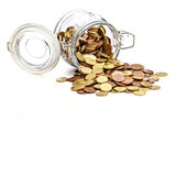 Pot en verre avec des pièces de monnaie Images libres de droits