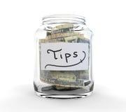 Pot en verre clair pour des bouts avec des pièces de monnaie et des factures Images stock