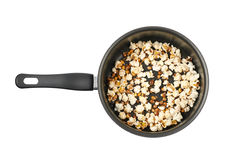 Pot filled with the popcorn isolated Stock Photography
