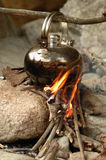 Pot on the Fire. A pot on the fire for boiling water on outdoor Royalty Free Stock Image
