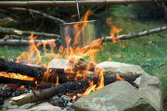 Pot on fire. Cooking meal on fire. Spring, in the forest stock photography