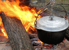 The pot and fire. Royalty Free Stock Images