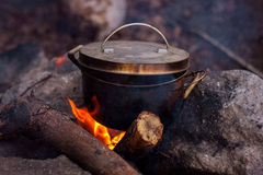 Pot on fire. In camp during a hike in the mountains Royalty Free Stock Photography