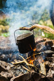 Pot on the fire. Cooking food in a pot on the fire Stock Photos
