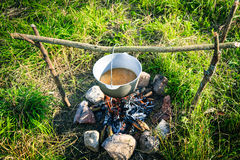 Pot on the fire with a hot soup Royalty Free Stock Photo