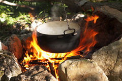 Pot on the fire Stock Images