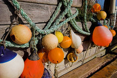 Pot floats. Lobster pot lfoats hanging on a wooden wall Stock Image