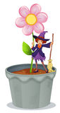 A pot with a flower and a witch at the top Stock Image