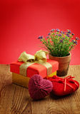 Pot of Flowers with Gift Box and Hearts Royalty Free Stock Photos