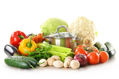 Pot and fresh vegetables isolated on white Stock Photography