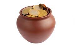 Pot full of coins Stock Photos