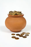Pot full of gold coins. Clay pot with gold coins on a white background Stock Photos