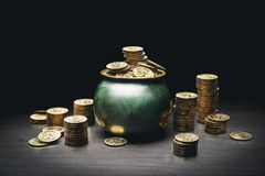 Pot full of gold coins. On a wooden surface and dark background / saint patricks day concept / 3d elements composited in stock photo