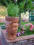 Pot in a garden Royalty Free Stock Photo
