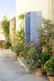 Pot garden in a narrow street, typical in southern Europe, Ansou Stock Photos