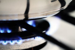 Pot on gas. Pot on blue flame of gas Royalty Free Stock Photo