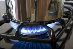 Pot on a gas burner Stock Images