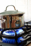 Pot on a gas stove Royalty Free Stock Photography