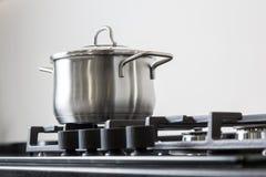 Pot on a gas stove Royalty Free Stock Photos