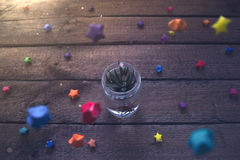 Pot in a glass jar with colorful stars Stock Images