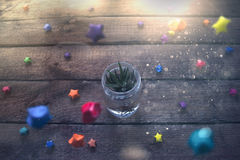 Pot in a glass jar with colorful stars Stock Image