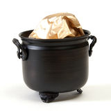 Pot of Gold. A pot of gold isolated on a white background Royalty Free Stock Photography