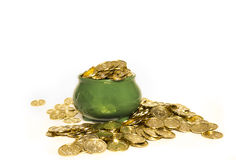 Pot of Gold. A green pot with shamrocks full of gold coins isolated on white Stock Photo