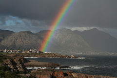 POT OF GOLD. An extremely bright rainbow over the village of Hermanus,South Africa Royalty Free Stock Photography