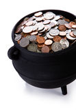 Pot of Gold: Full Of American Coins. Series with a cauldron holding riches.  Good for St. Patrick's Day holiday or other money related concepts Royalty Free Stock Images