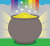 Pot of Gold. A glowing pot of gold is resting at the end of the rainbow Stock Photo
