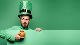 Pot of gold. Green patricks background. Man in Saint Patrick`s Day leprechaun party hat having fun on green background. Pot of gold. Green patricks background royalty free stock photos