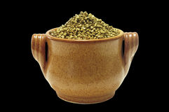Pot of gold isolated. Pot filled with gold nuggets over black Stock Photos