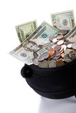Pot of Gold: Isolated Pot Full Of US Currency. Series with a cauldron holding riches.  Good for St. Patrick's Day holiday or other money related concepts Royalty Free Stock Photography