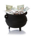 Pot of Gold: Isolated Pot Full Of US Currency. Series with a cauldron holding riches.  Good for St. Patrick's Day holiday or other money related concepts Stock Image