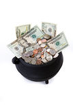 Pot of Gold: Isolated Pot Full Of US Currency. Series with a cauldron holding riches.  Good for St. Patrick`s Day holiday or other money related concepts Stock Image