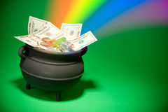 Pot of Gold: Magical Treasure with Cash and Rainbow royalty free stock photography