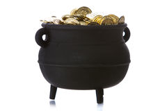 Pot of Gold: Pot Full Of Gold Isolated on White. Series with a cauldron holding riches.  Good for St. Patrick's Day holiday or other money related concepts Stock Image
