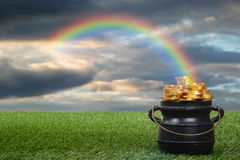 Pot of gold with rainbow. Closeup of pot of gold with rainbow stock photo