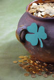 Pot of gold and a shamrock leaf. Close-up. Happy St. Patrick`s Day .A pot full of gold coins and shamrock leaf.Luck of the Irish: A pot of Gold sits amongst the royalty free stock photos